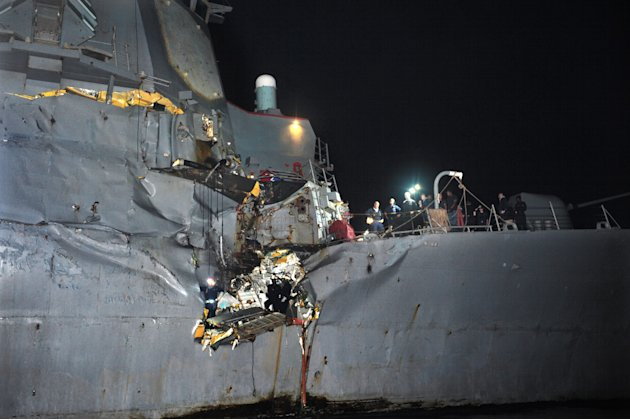 In this image released by the U.S. Navy, the U.S. Navy's guided-missile destroyer is seen damaged after it collided with a Japanese-owned oil tanker just outside the strategic Strait of Hormuz, Sunday, Aug. 12, 2012. The collision left a gaping hole in the starboard side of USS Porter but no one was injured on either vessel, the U.S. Navy said in a statement.