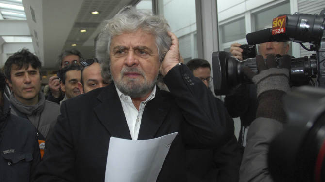 Five Stars movement leader Beppe Grillo arrives in Siena, Italy, Friday, Jan. 25, 2013, to participate in a meeting of shareholders of embattled Italian bank Monte dei Paschi di Siena, who lining up to question managers about a scandal involving potential trading losses that had reportedly been concealed. The world's oldest running bank convened shareholders Friday in Siena to approve capital increases as a condition to receive up to €3.9 billion ($5.22 billion) in state aid. The scandal over the trades caused shares to plunge this week and became a flashpoint in the campaign for national elections. (AP Photo/Riccardo Sanesi, Lapresse) ITALY OUT