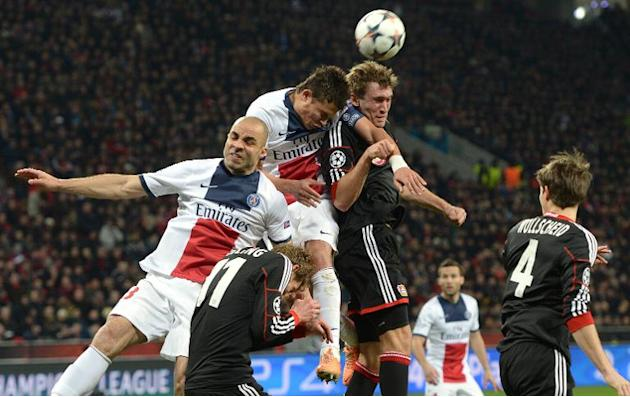 Paris Saint-Germain's players fight for the ball during their first-leg round of 16 UEFA Champions League match against Bayer Leverkusen, in Leverkusen, western Germany, on February 18, 2014