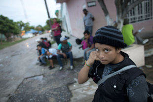 CLICK IMAGE for slideshow: In this June 19, 2014 photo, a 14-year-old Guatemalan girl traveling alone waits for a northbound freight train along with other Central American migrants, in Arriaga, Chiapas state, Mexico. The United States has seen a dramatic increase in the number of Central American migrants crossing into its territory, particularly children traveling without any adult guardian. More than 52,000 unaccompanied children have been apprehended since October. (AP Photo/Rebecca Blackwell)