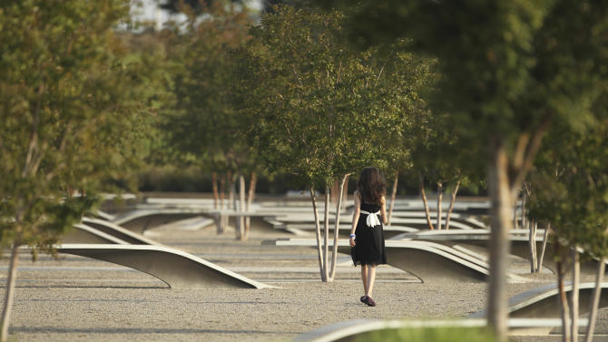 A young relative of one of the victims of the attack on the Pentagon walks through the memorial for the victims during ceremonies in Washington