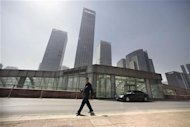 A security guard walks in front of Yintai Centre in Beijing&#39;s central business district