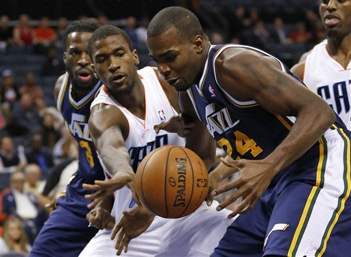 Utah Jazz&#39;s Paul Millsap, right, and Charlotte Bobcats&#39; Michael Kidd-Gilchrist, left, chase a loose ball during the first half of an NBA basketball game in Charlotte, N.C., Wednesday, Jan. 9, 2013. (AP Photo/Chuck Burton)