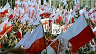 People demonstrate in Warsaw against Poland's centrist government in a rally called by unions, an ultra-Catholic movement and politicians