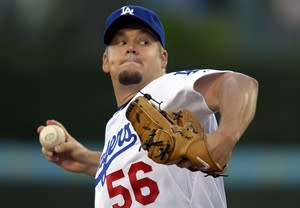 FILE - In this Sept. 29, 2012, file photo, Los Angeles Dodgers starting pitcher Joe Blanton throws to the plate during the first inning of a baseball game against the Colorado Rockies in Los Angeles. The Los Angeles Angels added two more new arms to their retooled pitching staff on Wednesday, Dec. 5, by agreeing to a $15 million, two-year contract with Blanton and an $8 million, two-year deal with left-handed reliever Sean Burnett. (AP Photo/Mark J. Terrill, File)