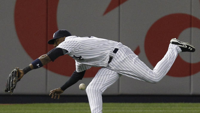 New York Yankees shortstop Eduardo Nunez commits a fielding error on Nick Johnson's sixth-inning hit that allowed two-runs to score during the Yankees baseball game against the Baltimore Orioles at Yankee Stadium in New York, Tuesday, May 1, 2012. (AP Photo/Kathy Willens)