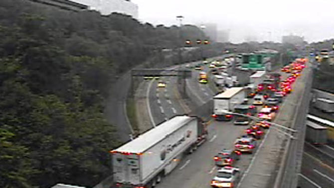 This image provided by the New Jersey Department of Transportation shows the traffic backup at 5:56 a.m. EDT Thursday June 12, 2014 following a fatal accident that has closed the upper level into New York City on the George Washington Bridge. This camera is located on Route 4 at the I-95 approach to the George Washington Bridge. The Port Authority says that the trucks crashed shortly before 2:30 a.m. Thursday closing the upper level into New York City on the GWB. (AP Photo/NJ DOT)