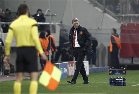 Manchester United's coach Moyes reacts during a Champions League round of 16 first leg soccer match against Olympiakos in Piraeus, near Athens,