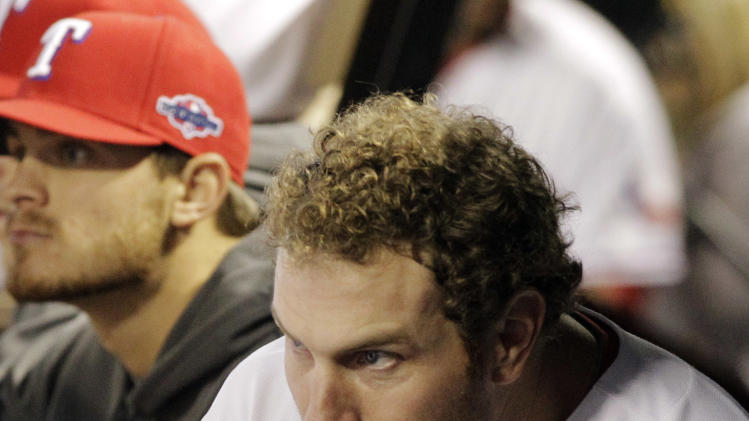 Texas Rangers center fielder Josh Hamilton, right, watches from the dugout during the seventh inning of an American League wild-card playoff baseball game against the Baltimore Orioles on Friday, Oct. 5, 2012, in Arlington, Texas. (AP Photo/Tony Gutierrez)