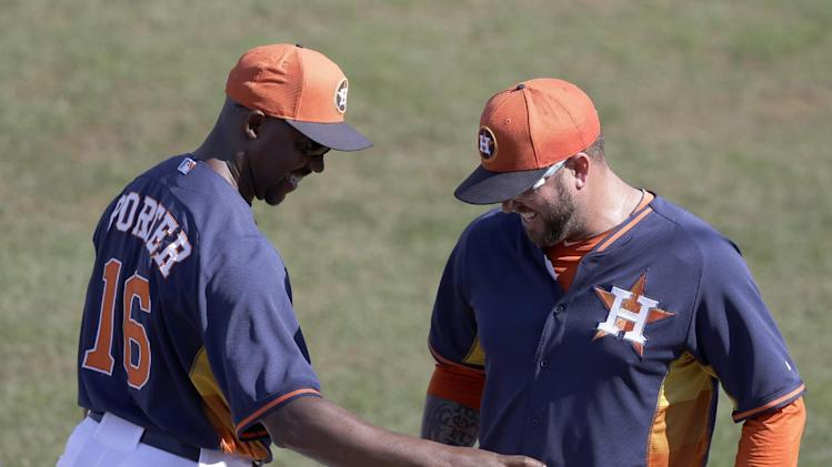 Houston Astros manager Bo Porter, left, gives relief pitcher Peter Moylan the ball after their 4-3 win over the Toronto Blue Jays during a spring training baseball game in Kissimmee, Fla., Sunday, March 9, 2014