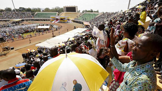 Faithful are seen as Pope Francis leads a mass at the Bangui stadium, Central African Republic