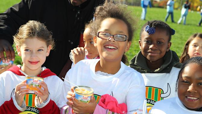 IMAGE DISTRIBUTED FOR LIBBY'S-Members of the Buffalo Soccer Club enjoy Libby's Single Fruit Cups at the Libby's Snack Duty Takeover on Saturday, Oct. 6, 2012 in Buffalo, NY. (Photo by Bill Wippert/Invision for Libby's/AP Images)