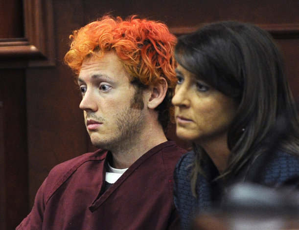 FILE - In this Monday, July 23, 2012 file photo, James Holmes, accused of killing 12 people in Friday&#39;s shooting rampage in an Aurora, Colo., movie theater, appears in Arapahoe County District Court with defense attorney Tamara Brady in Centennial, Colo. A court hearing Thursday, Aug. 30, 2012 will examine Holmes&#39; relationship with a University of Colorado psychiatrist to whom he mailed a package containing a notebook that reportedly contains violent descriptions of an attack. His attorneys say Holmes is mentally ill and that he sought help from psychiatrist Lynne Fenton at the school, where he was a Ph.D. student, until shortly before the July 20 shooting. Prosecutors allege Holmes may have been angry at the failure of a once promising academic career. (AP Photo/Denver Post, RJ Sangosti, Pool, File)