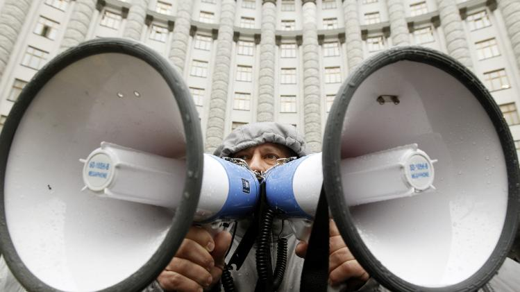 A man talks using speakers during a rally in support of EU integration in front of the Ukrainian cabinet of ministers building in Kiev