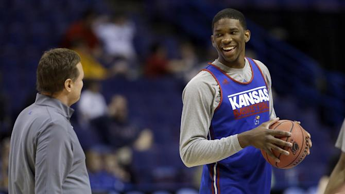 Kansas' Joel Embiid, right, talks with head coach Bill Self during practice for the NCAA college basketball tournament Thursday, March 20, 2014, in St. Louis. Kansas is scheduled to play Eastern Kentucky in a second-round game on Friday