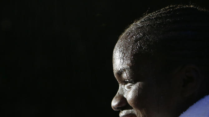 Great  Britain's Nicola Adams leaves the ring following a fight against  India's Chungneijang Mery Kom Hmangte in the women's flyweight 51-kg semifinal boxing match at the 2012 Summer Olympics, Wednesday, Aug. 8, 2012, in London. (AP Photo/Ivan Sekretarev)