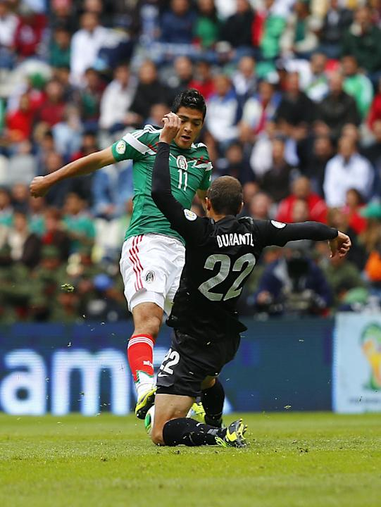 Mexico's Raul Jimenez, top left, fights for the ball with New Zealand's Ivan Vicelich at a 2014 World Cup qualifying soccer match in Mexico City, Wednesday, Nov. 13, 2013