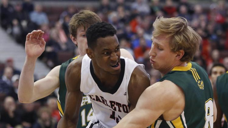 University of Alberta Golden Bears' Baker guards Carleton University Ravens' Pierre-Charles during their Canadian Interuniversity Sport semi-final basketball game in Ottawa