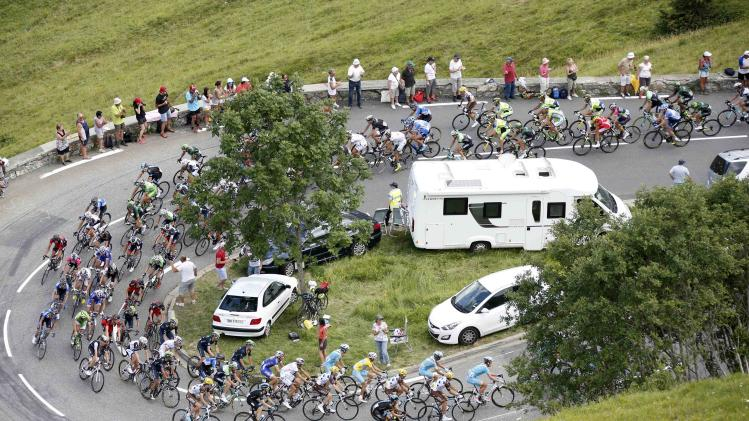 The pack of riders cycles on its way in the Pyrenees mountains during the 124.5km seventeenth stage of the Tour de France cycle race