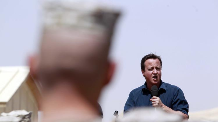 Britain's Prime Minister David Cameron delivers a speech to British and US troops during a visit to Camp Bastion, outside Lashkar Gah, the provincial capital of Helmand province in south Afghanistan, Monday, July 4, 2011. (AP Photo/Lefteris Pitarakis, pool)