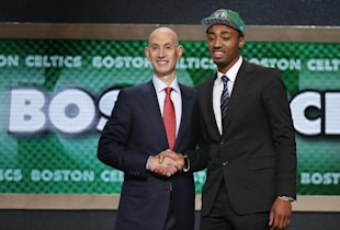 James Young poses with NBA Commissioner Adam Silver. (AP)