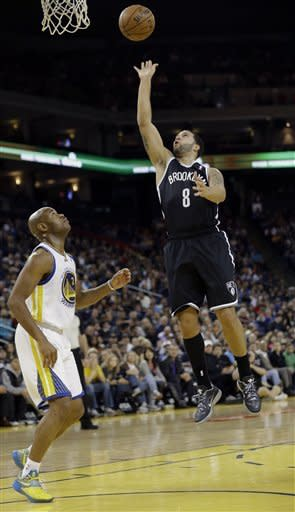 Thompson rallies Warriors past Nets 102-93
