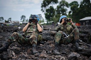 UN peacekeepers look through binoculars at M23 rebel …