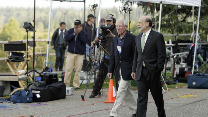 """Federal Reserve Chairman Ben Bernanke, right, and Bank of Israel Governor Stanley Fischer walk together past television cameras outside of the Jackson Hole Economic Symposium, Friday, Aug. 31, 2012, at Grand Teton National Park near Jackson Hole, Wyo. Bernanke made clear Friday that the Federal Reserve will do more to boost the economy because of high U.S. unemployment and an economic recovery that remains """"far from satisfactory."""" (AP Photo/Ted S. Warren)"""