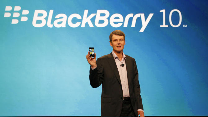 FILE - In this May 1, 2012 file photo, Thorsten Heins, president and CEO of Research In Motion, delivers the keynote speech during the BlackBerry World conference in Orlando, Fla. These are troubling times for Waterloo, Ontario, Canada, the town of 100,000 that was transformed by Research In Motion's BlackBerry into Canada's Silicon Valley. (AP Photo/Reinhold Matay, File)
