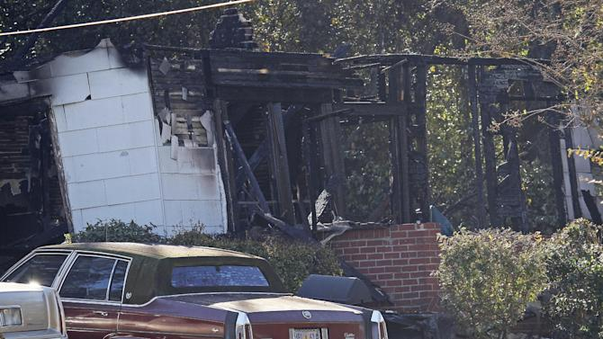 A burned out home in west Jackson, Miss., awaits inspection Wednesday, Nov. 14, 2012, by National Transportation Safety Board investigators following a Tuesday evening crash by a small aircraft. Authorities say the small plane carrying three people crashed shortly after 5 p.m. Tuesday evening. The home's resident escaped with non-life threatening injuries but all three pilots aboard the plane were killed, authorities said. (AP Photo/Rogelio V. Solis)
