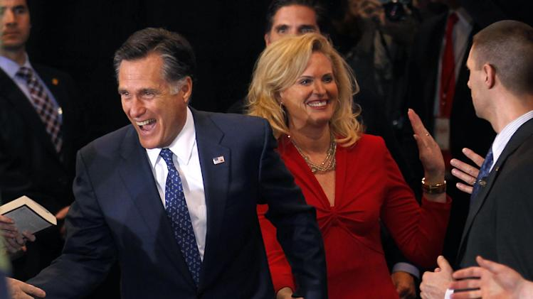 Republican presidential candidate, former Massachusetts Gov. Mitt Romney, arrives with his wife Ann at his election watch party after winning the Michigan primary in Novi, Mich., Tuesday, Feb. 28, 2012. (AP Photo/Gerald Herbert)