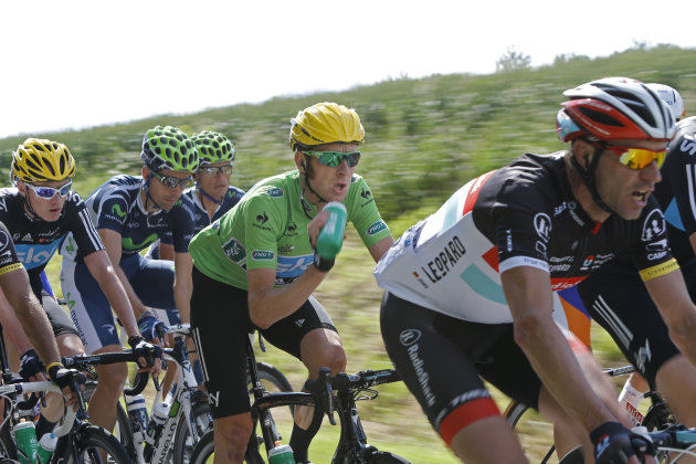 Bradley Wiggings of Britain, wearing the best sprinter's green jersey, drinks as he rides in the pack during the first stage of the Tour de France cycling race over 198 kilometers (123 miles) with sta