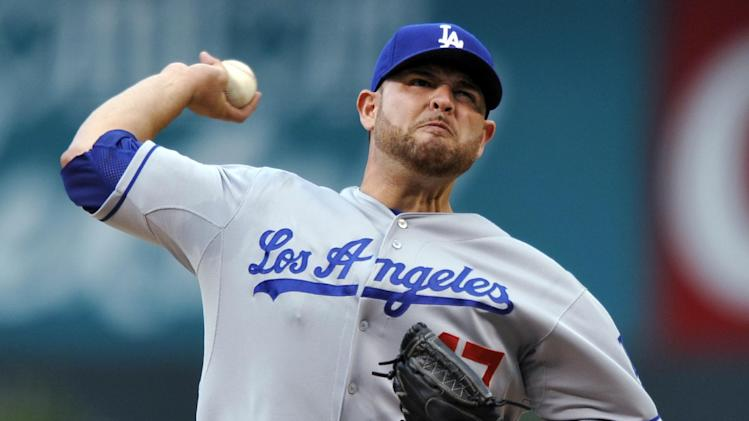Nolasco leads Dodgers past Rockies 7-4