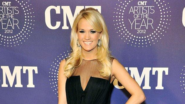 Following in Hayden's footsteps at the star-studded fete was country music superstar Carrie Underwood, who appeared effortlessly chic in an understated Katharine Kidd jumpsuit and capped-toe pumps. Now all she needs to do is tame that feathered, pageant-like mane. (12/3/2012)
