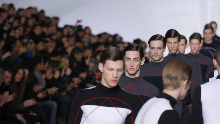 Models wear creations by Belgian fashion designer Kris Van Assche for Christian Dior's fall-winter 2013/2014 men's fashion collection, presented in Paris, Saturday, Jan.19, 2013. (AP Photo/Jacques Brinon)
