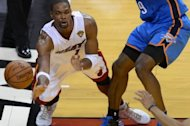 Miami forward Chris Bosh, pictured June 21, will miss the London Olympics recovering from an abdominal injury, the second player from the NBA champion Heat to announce his withdrawal from the US team