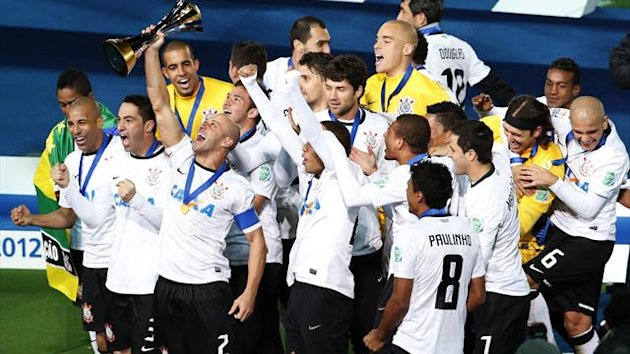 Players of Brazil's Corinthians celebrate at the podium after defeating Britain's Chelsea to win the FIFA Club World Cup final
