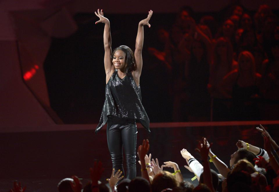 Olympic gymnast Gabrielle Douglas performs onstage at the MTV Video Music Awards on Thursday, Sept. 6, 2012, in Los Angeles. (Photo by Mark J. Terrill/Invision/AP)