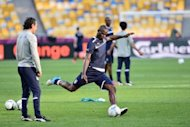 Italian forward Mario Balotelli (R) kicks the ball in front of headcoach Cesare Prandelli during a team training session on June 30. Having beaten Germany 2-1 in Thursday's second semi-final, 1968 title-winners Italy will contest a Euro final for the first time since their extra-time loss to France in 2000