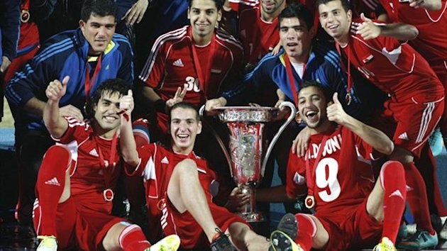 Players of Syria pose with the trophy after winning their West Asian Football Federation (WAFF) Championship final soccer match against Iraq in Kuwait City (Reuters)