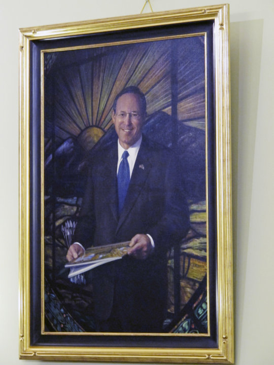 In this Jan. 3, 2013 photo, the portrait of former Gov. Bob Taft hangs in a hearing room at the Statehouse in Columbus, Ohio. Artists often put oil to canvas at this time of year to render official po
