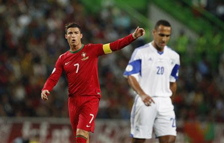 Portugal's Cristiano Ronaldo gestures near Israel's Mahran Radi during their 2014 World Cup qualifying soccer match against Israel at Alvalade stadium in Lisbon