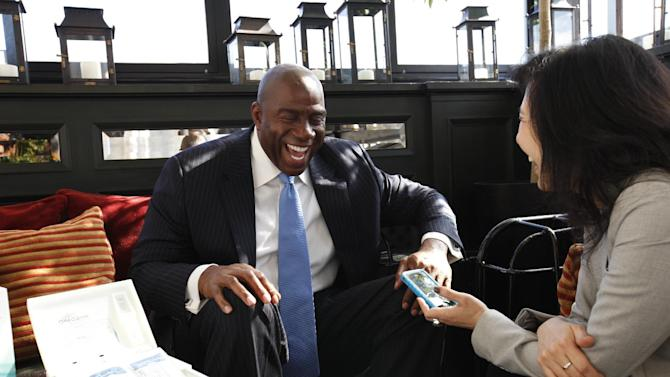 """IMAGE DISTRIBUTED FOR ORAQUICK - OraSure Technologies and Earvin """"Magic"""" Johnson get interviewed at the announcement of the nationwide availability of OraQuick® In-Home HIV Test, the first and only rapid over-the-counter (OTC) HIV test on Wednesday, Oct. 10, 2012 in New York. (Photo by Amy Sussman/Invision for OraQuick/AP Images)"""