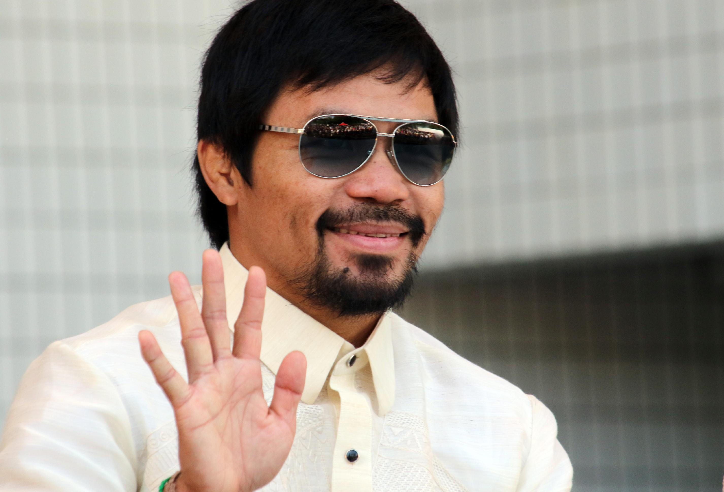 Pacquiao says in talks with Mayweather and Khan