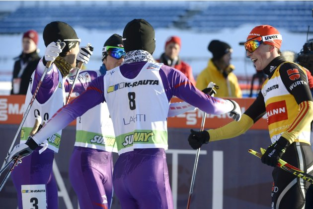 Japan's Yoshito Watabe, Taihei Kato and Akito Watabe celebrate with winner Germany's Eric Frenzel after the Nordic Combined individual Gundersen 10 km cross country skiing event at the FIS World Cup L
