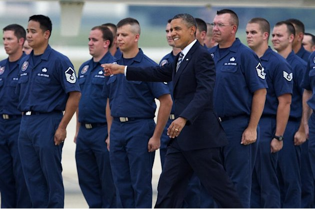 President Barack Obama greets members of the Presidential Logistics Squadron who maintains Air Force One fleet, during a ceremony presenting one of it's planes after a year-long depot level maintenanc