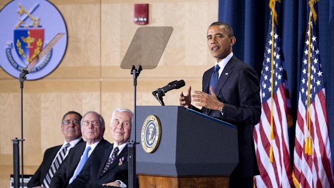 President Barack Obama delivers his speech to the Nunn-Lugar Cooperative Threat Reduction (CTR) symposium at the National Defense University in Washington, Monday, Dec. 3, 2012. Seated are, from left Defense Secretary Leon Panetta, Sens. Sam Nunn and Richard Lugar. (AP Photo/Manuel Balce Ceneta)