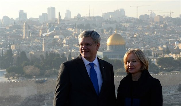 Prime Minister Stephen Harper and wife Laureen visit Mount of Olives in Jerusalem, Israel, on Sunday, January 19, 2014. Dome of the Rock in the Old City of Jerusalem is seen in the background. While in the Middle East Harper will be visiting Israel, West Bank, and Jordan. THE CANADIAN PRESS/Sean Kilpatrick