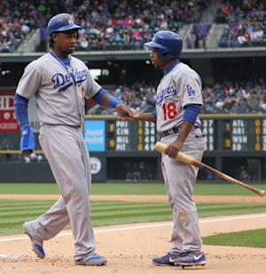 Dodgers beat Rockies in rain-shortened game