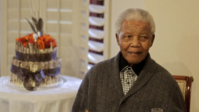 FILE - In this Wednesday, July 18, 2012 file photo former South African President Nelson Mandela as he celebrates his birthday with family in Qunu, South Africa, Wednesday, July 18, 2012. The South African presidency says Nelson Mandela was re-admitted to hospital with a recurrence of a lung infection Thursday March 28, 2013. (AP Photo/Schalk van Zuydam)